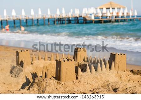 Sand Castle on Beach of Side with sand at sundown - stock photo