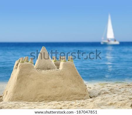 Sand Castle on Beach on summer day - stock photo