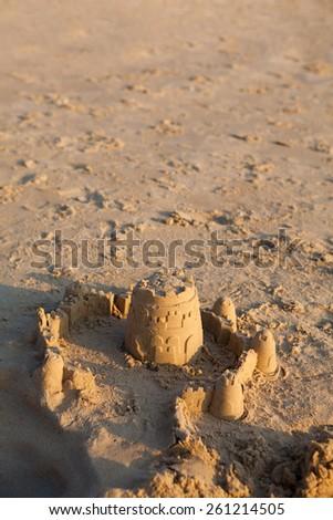 Sand Castle on Beach. Sunset time. - stock photo