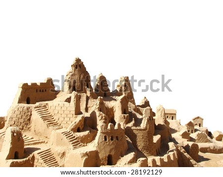 sand castle on the beach isolated on white
