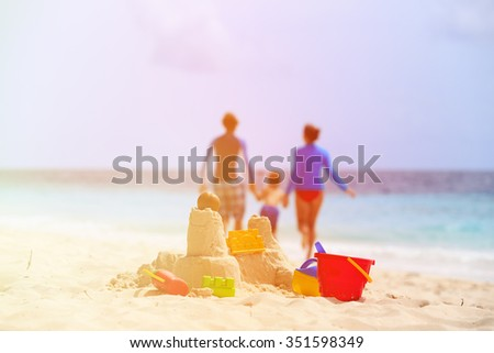 sand castle on tropical beach, family vacation concept
