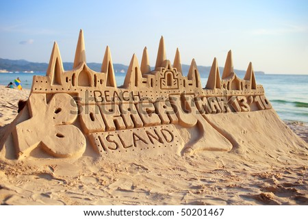 Sand castle on tropical white sand beach before sunset in Boracay, Philippines - stock photo