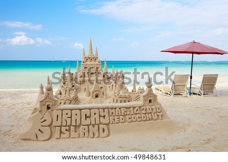 Sand castle on tropical white sand beach in Boracay, Philippines - stock photo