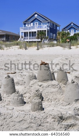 Sand Castle with Beach Rental in background, perfect for cover art - stock photo