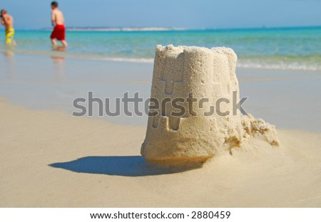 Sand Castle with Children in Background - stock photo