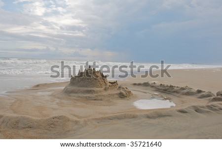 Sand castle with moat around it at Emerald Isle North Carolina. - stock photo