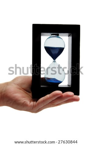 Sand clock in the hand - stock photo