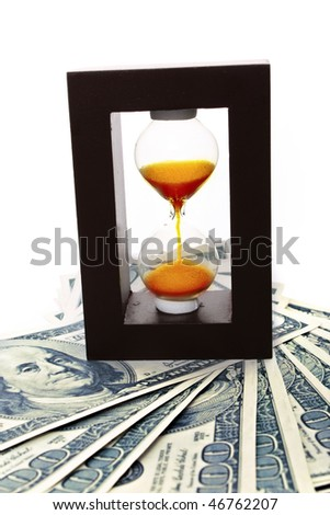 Sand clock with gold on dollar banknotes - stock photo