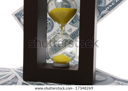 Sand clock with gold sand on dollar background - stock photo