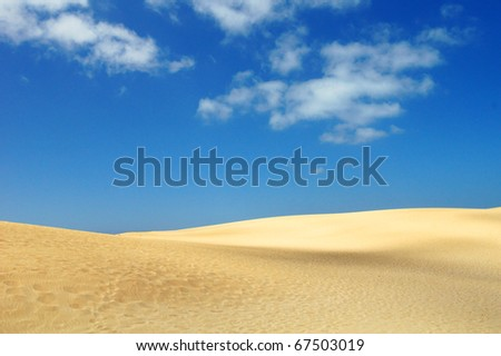 sand desert and blue sky with clouds - stock photo
