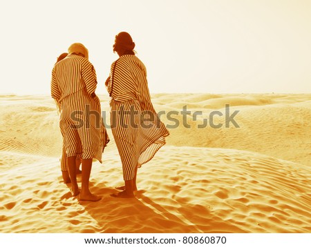 Sand desert and people, Sahara horizon - stock photo