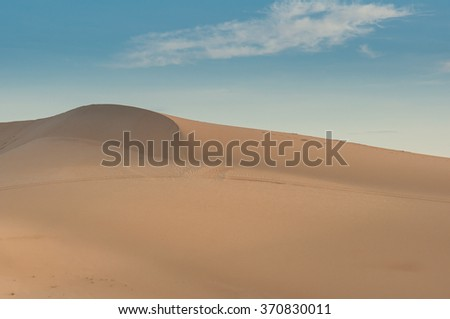 Sand desert with blue sky and white cloud
