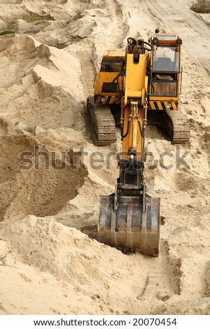 Sand digging in the woods. Open mining.