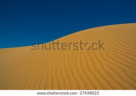Sand dune against the sky in Patagonia, Argentina.