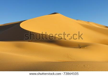Sand Dune at Sunset in the Awbari Sand Sea, Sahara Desert, Libya - stock photo