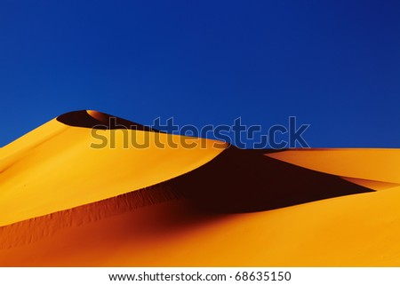 Sand dune in Sahara Desert at sunset, Algeria