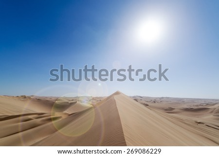 Sand dune landscape with lens flare at Huacachina, Peru - stock photo