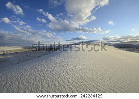 Sand Dune Patterns and Dramatic Blue Sky - stock photo