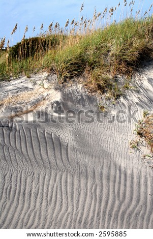 Sand dune patterns created by wind and rain erosion. - stock photo