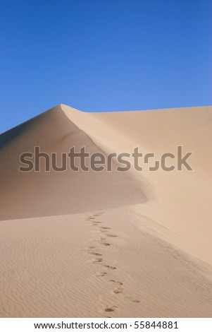 Sand Dune with Foot Prints - stock photo
