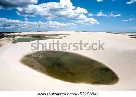 sand dune with oasis lagoon of tatajuba near jericoacoara in ceara state in brazil - stock photo