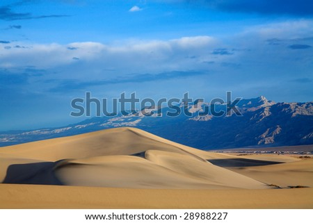 Sand Dunes Amid Mountain Peaks, Death Valley National Park, California - stock photo