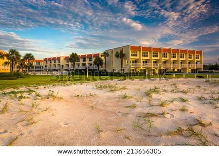 Sand dunes and beachfront hotel at St. Augustine Beach, Florida. - stock photo