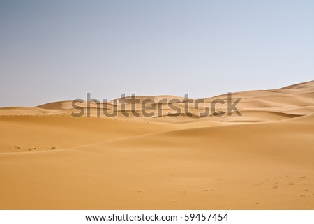 sand dunes and cloudless sky - stock photo