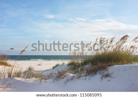 Sand dunes and ocean at sunset, Pensacola, Florida. - stock photo