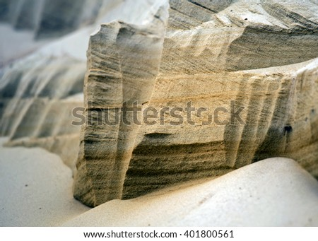 Sand dunes and rocks in the sand - stock photo