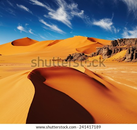 Sand dunes and rocks, Sahara Desert, Algeria  - stock photo