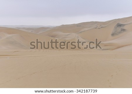 Sand dunes around Huacachina in the coastal desert of Peru - stock photo