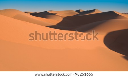 Sand dunes at sunset, Sahara, Morocco - stock photo