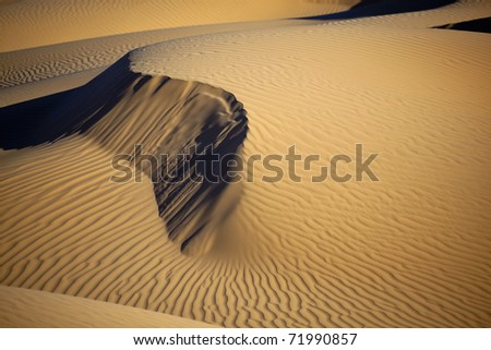 Sand dunes in daylight with shadows. Concept for holidays and traveling. - stock photo