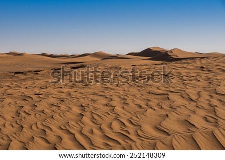 Sand dunes in Erg Chigaga in the Sahara in Morocco. - stock photo