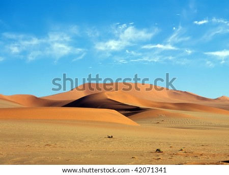 Sand dunes in the Namib Desert - stock photo