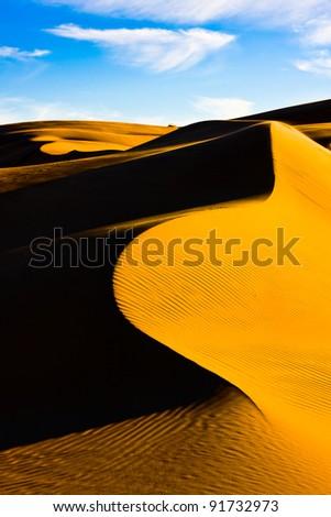 Sand dunes in the Namibian desert - stock photo