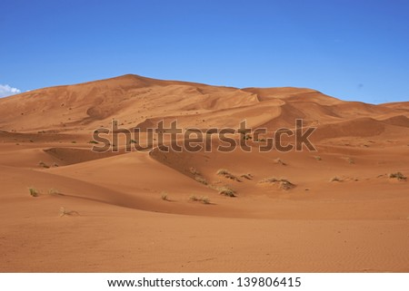 Sand dunes in the Sahara Desert of Morocco in North Africa - stock photo