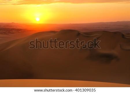 Sand dunes near Huacachina at sunset in Ica region, Peru. - stock photo