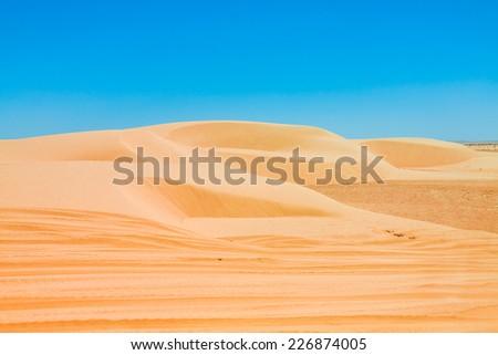 Sand dunes of Sahara desert near Ong Jemel in Tozeur,Tunisia. - stock photo