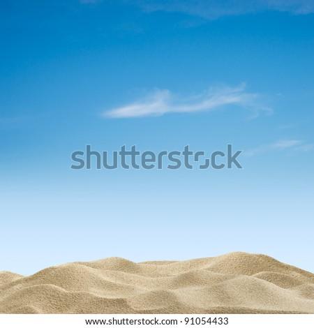 Sand dunes on blue sky background - stock photo