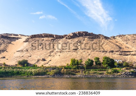 Sand dunes on the Coastline of the Nile river part called First Cataract, Aswan, Egypt