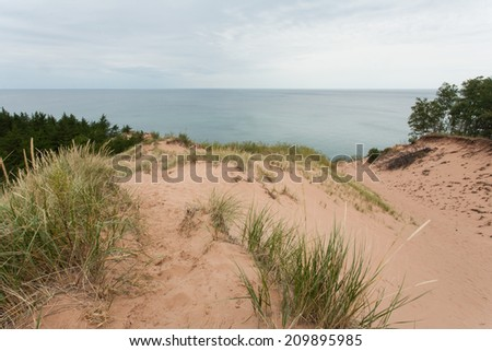Sand dunes on the shore of Lake Superior.  Pictured Rocks National Seashore, MI, USA. - stock photo