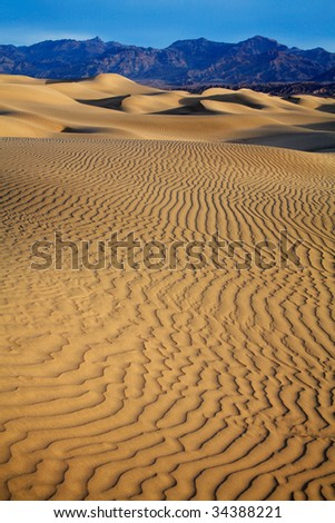 Sand Dunes, Ripples And Mountain Peaks, Death Valley National Park, California - stock photo