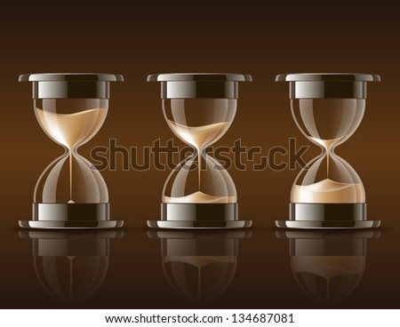 Sand falling in the hourglass in three different states on dark background. - stock photo