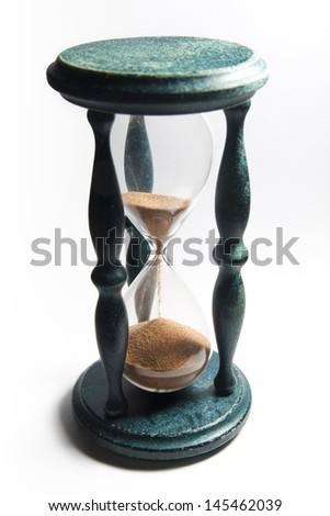 Sand-glass counts time isolated on a white background - stock photo