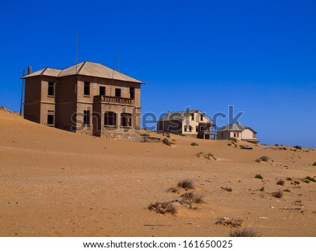 Sand in abandoned house in Kolmanskop ghost town (Namibia) - stock photo