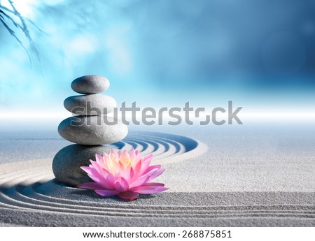 sand, lily and spa stones in zen garden  - stock photo
