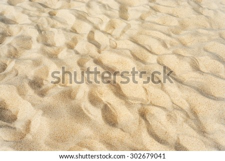 sand on beach as textured background - stock photo