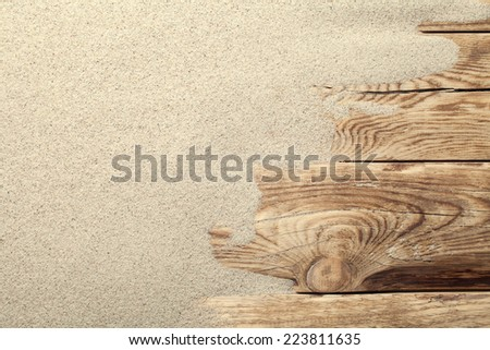 Sand on planked wood. Summer background with copy space. Top view - stock photo